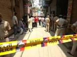 india police find bodies of 11 family members hanging from the roof