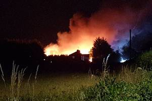 waltham abbey bungalow fire: 11 crews battle 15-metre high flames which consumed industrial unit
