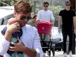 tom daley and husband dustin lance black pictured with newborn son robert ray for the first time