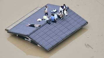 japan floods: military airlift people to safety from flood waters