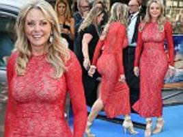 carol vorderman flaunts her curves in red lace gown at spitfire bash