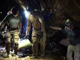 navy seal footage shows the moment 'tranquilised' thai cave boys pulled to safety
