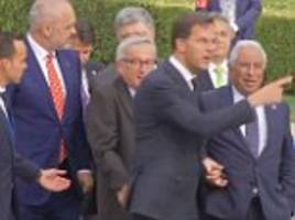 Jean-Claude Juncker loses his balance ahead of dinner at NATO summit