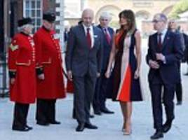 First Lady Melania Trump meets Chelsea pensioners as she arrives for hospital tour with Philip May