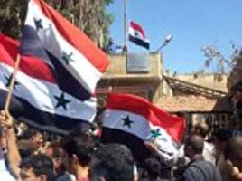 Syrian army enters and raises flag in rebel-held city of Darra