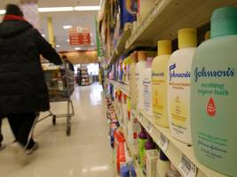 Johnson & Johnson is sliding after a jury awarded $4.69 billion to 22 women who said its talcum baby powder gave them cancer
