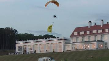 donald trump: paragliding protester flies over president's scottish hotel