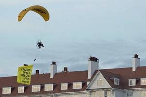 cops hunt donald trump greenpeace protester who dropped in on turnberry golf resort