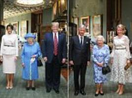 the queen smiles with the belgian king and queen at windsor castle
