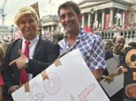 Senior BBC presenter participated in anti-Trump protests proudly posing with 'Go Home' sign
