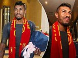 paulinho arrives back in china to be greeted by fans and flowers