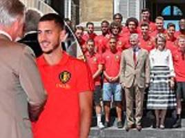 Thousands of Belgium fans gather to welcome back World Cup stars as they are greeted by royal family