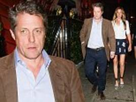hugh grant, 57, looks dapper while wife anna eberstein, 39, shows off her lengthy legs