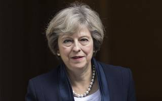 theresa may tells conservative rebels to back her or lose brexit