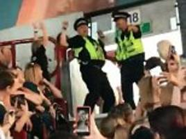 Police officers on duty at a Little Mix concert break into the flossing dance from hit game Fortnite