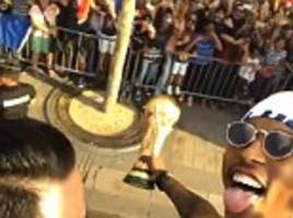france stars toast world cup success with open top parade through paris