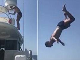 sergio ramos performs audacious backflip off the side of a yacht