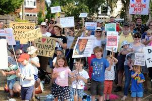 parents and children rally against donald trump's visit with a very sevenoaks protest