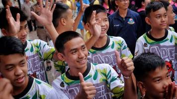 thai boys rescued from cave last week make first public appearance