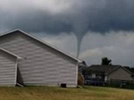 Dramatic video shows powerful tornadoes destroying rooftops of homes as they swept through Iowa
