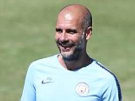 guardiola tells man city stars to return ready for title defence