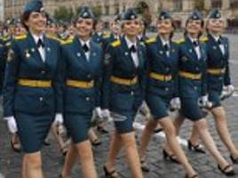 Female Russian students and cadets parade around Moscow's Red Square in graduation ceremony