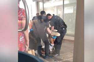 Moment man in Colchester with 'huge knife' restrained by police near shops