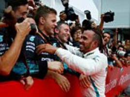 lewis hamilton rises from 14th to win rain-soaked german grand prix