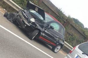 picture from m11 shows wreckage of crash causing huge delays