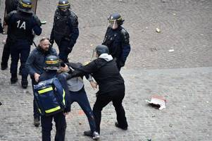 french president macron's bodyguard facing charges of beating may day protesters while dressed as a cop