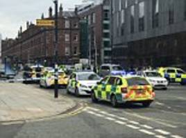 Armed police race to Hilton Hotel after woman with 'serious lacerations to her neck'
