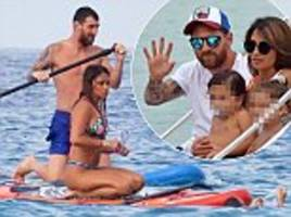 lionel messi goes paddle-boarding in ibiza with partner antonella roccuzzo