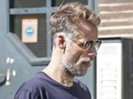 richard bacon steps out with plaster revealing where he had tracheotomy