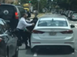 video shows driver nearly crushing man during greenpoint road rage fight