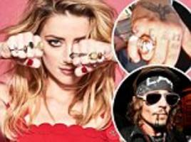 amber heard appears to poke fun at johnny depp's 'scum' tattoo