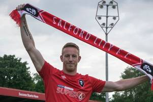 adam rooney opens up on salford city move and reveals he couldn't look at his phone for days due to backlash
