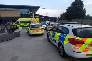five police vehicles and an ambulance scramble to lincoln's bus station as man is seen screaming and bleeding from the head