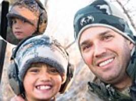 donald trump jr posts picture of son holding double barrel shotgun