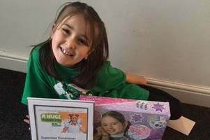 kind-hearted young girl, 7, given hero award for fundraising work