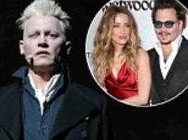 johnny depp in libel lawsuit filing accuses ex-wife amber heard of 'punching him twice in the face'