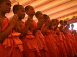 thai cave boys graduate as buddhist monks... but were they coerced into monastery?