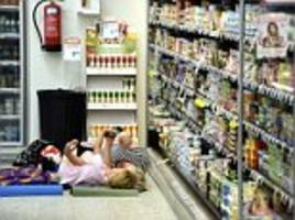 finnish grocery store sleepover cool-off in red-hot european heatwave as portugal and spain swelter