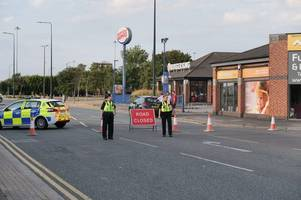 'bomb scare' as grimsby business is sealed off and major roads closed