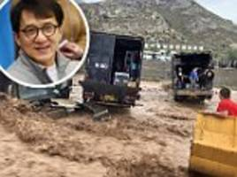kung fu star jackie chan and his crew are saved from raging flood waters