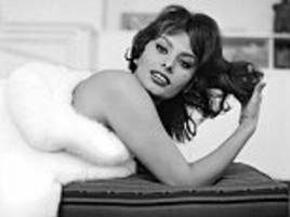 sophia loren and givenchy are seen in tony vaccaro photo exhibition