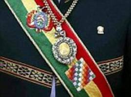 bolivian president's priceless medal and sash are stolen from a guard's car as he visits brothel
