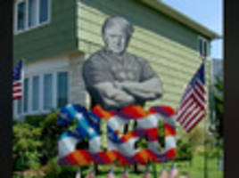 staten island 'creative patriot' erects brawny trump lawn art to 'provoke emotions'