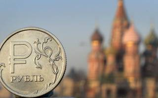 russia hits back at 'unacceptable' sanctions as rouble tumbles