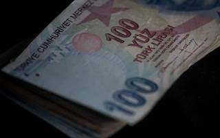 turkish lira sinks to new record lows amid geopolitical tensions