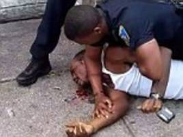 Baltimore police officer is suspended after disturbing video showed him punching and tackling man